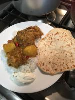 Curried chicken and rice with Naan bread