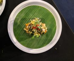 Steamed Sea bass in galangal, lemongrass & turmeric, wrapped in banana leaf & served with green mango salad - Chef Luke Nguyen