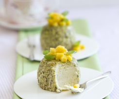 Steamed pistachio cheesecakes with mango
