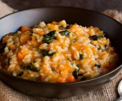 Pumpkin and chicken risotto with spinach and pinenuts