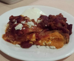 Eggplant Cannelloni filled with Feta & Pumpkin, topped with a Huevos Rancheros Sauce
