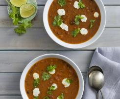 Black bean tomato soup with coriander lime cream
