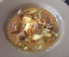 Coconut curry sausages with Mash potato
