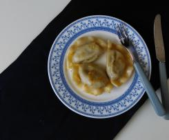 Pierogi with saurkraut and mushroom filling