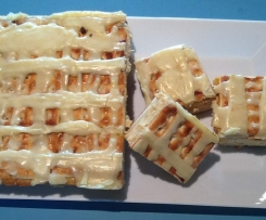 Salted caramel cheesecake slice with brown  butter icing.