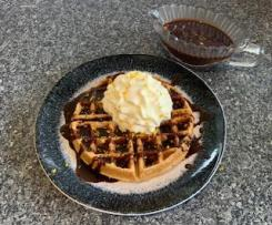 Christmas waffles with dark chocolate Cointreau pouring sauce