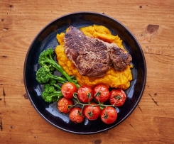 Beef with pumpkin mash, steamed vine tomatoes and broccolini