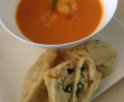 Prawn dumplings with tomato prawn soup