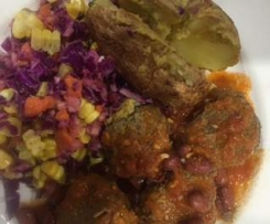 Mexican Meatballs, tomato sauce, baked potato and coleslaw