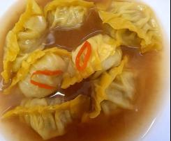 Potsticker dumplings and broth