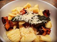Pan Fried Gnocchi with Roast Pumpkin and Burnt Sage Butter. Topped with parmesan cheese.